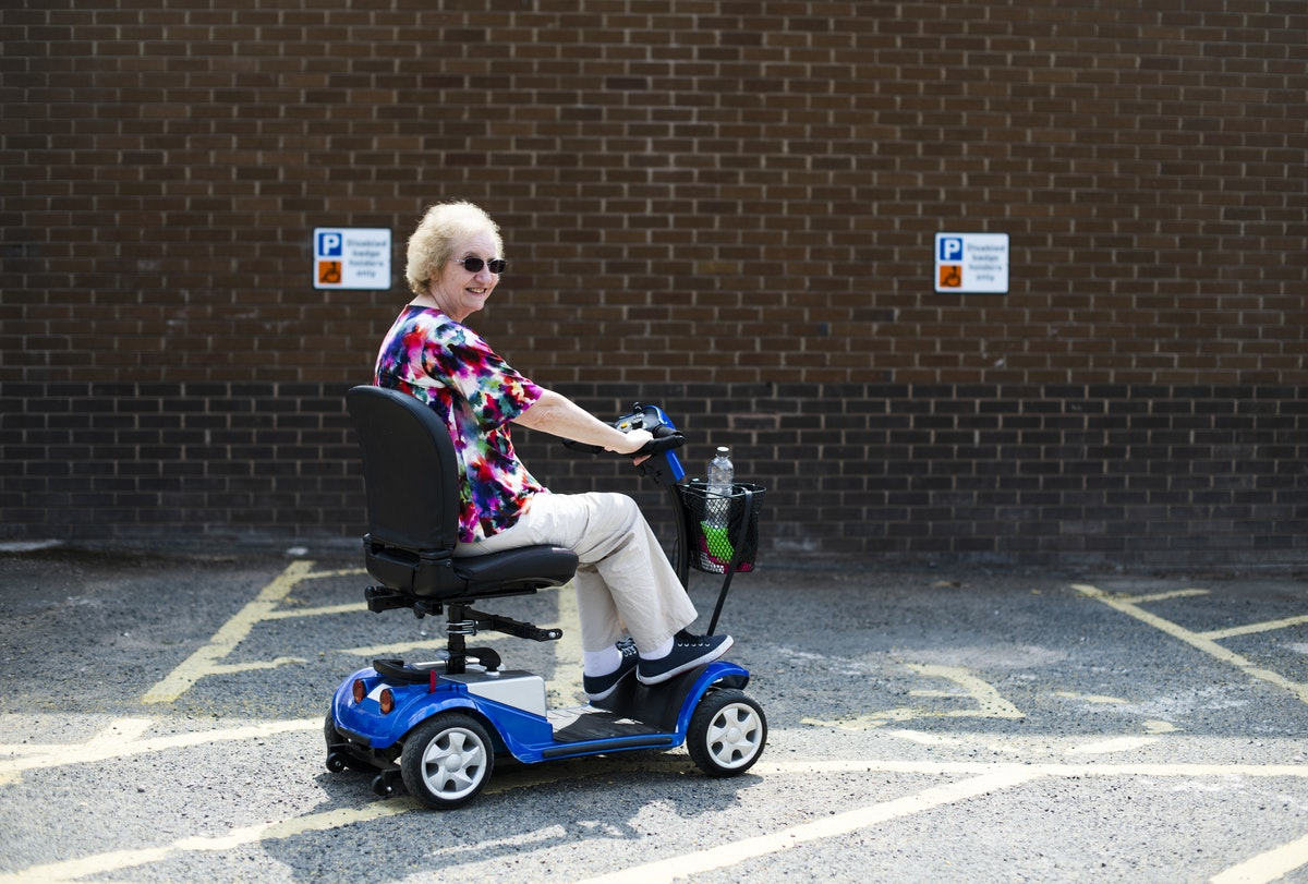 grandmother riding a mobility scooter