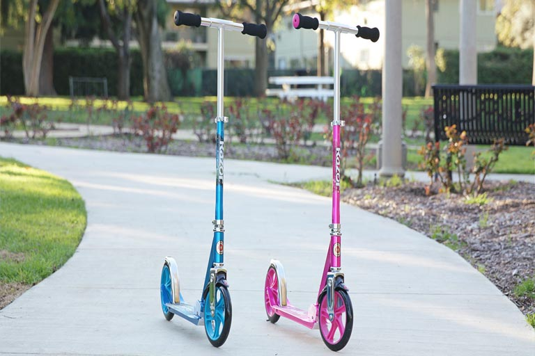 pink and blue colored razor a5 lux scooters standing in the park