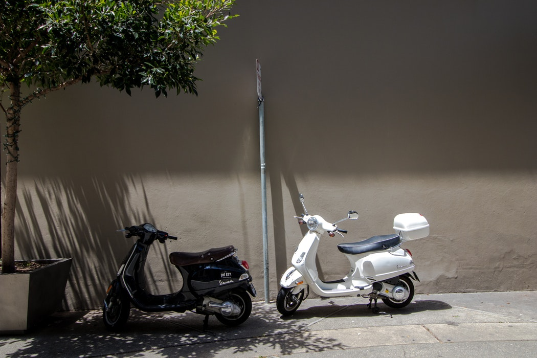 black and white motor scooter